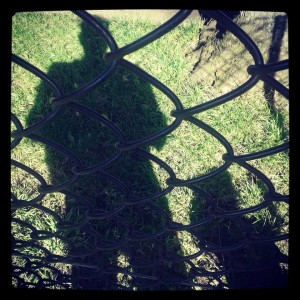 Celeste and Daddy in Shadow at a fence
